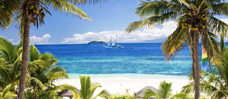 sail-boat-seen-through-palm-trees-mamanuca-group-islands-fiji-istock_000035487092_large-2