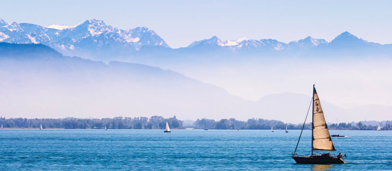 Boats on the Lake of Constance with the Alps in the back ground shutterstock_211194940-2