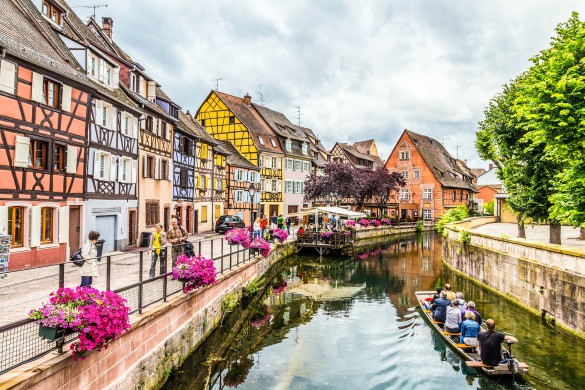 Colmar, France - July 3, 2013: people visit town of Colmar, France. Colmar has thousands of small canals and therefore people call it little Venice.